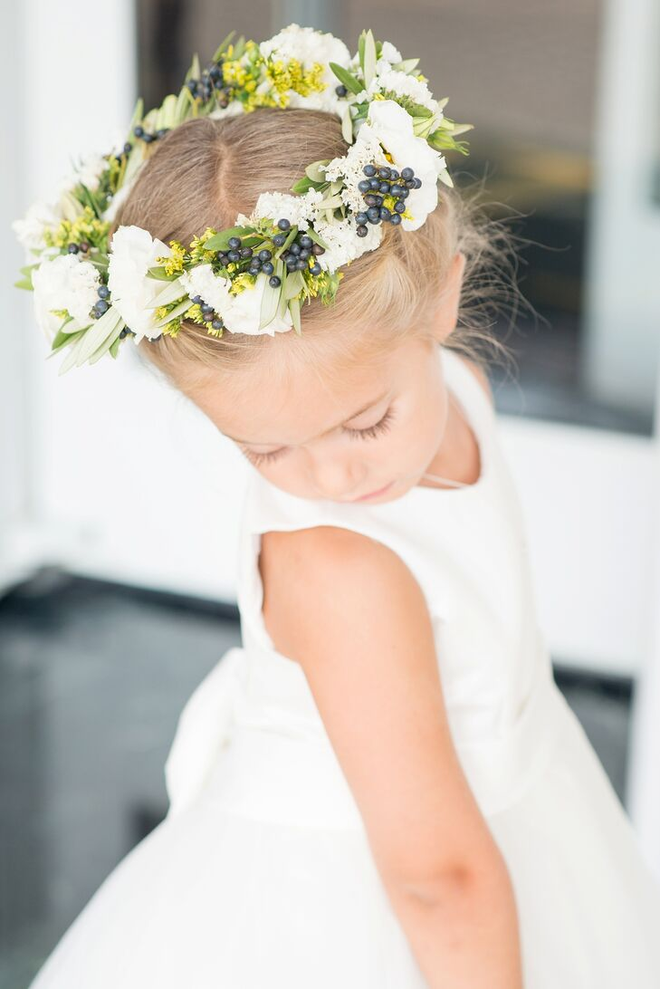 The flower girl was covered in blooms! Pam's niece match her white David's Bridal dress with a pomander of flowers, and also wore similar blooms on her head. Designed by Twisted Willow Flowers, the sweet flower crown included blueberries, white carnations, yellow stock flowers, baby's breath and greenery. (Now that's a fresh way to include a color scheme!)