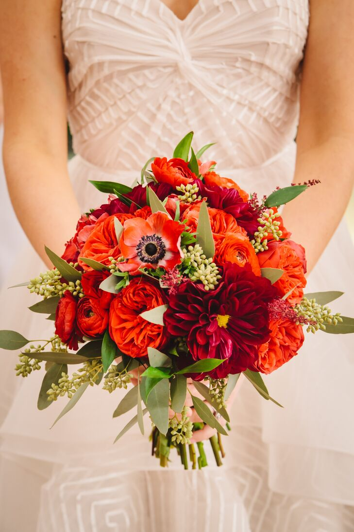 The bride carried a stunning red bouquet of anemones, garden roses, ranunculus and dahlias.