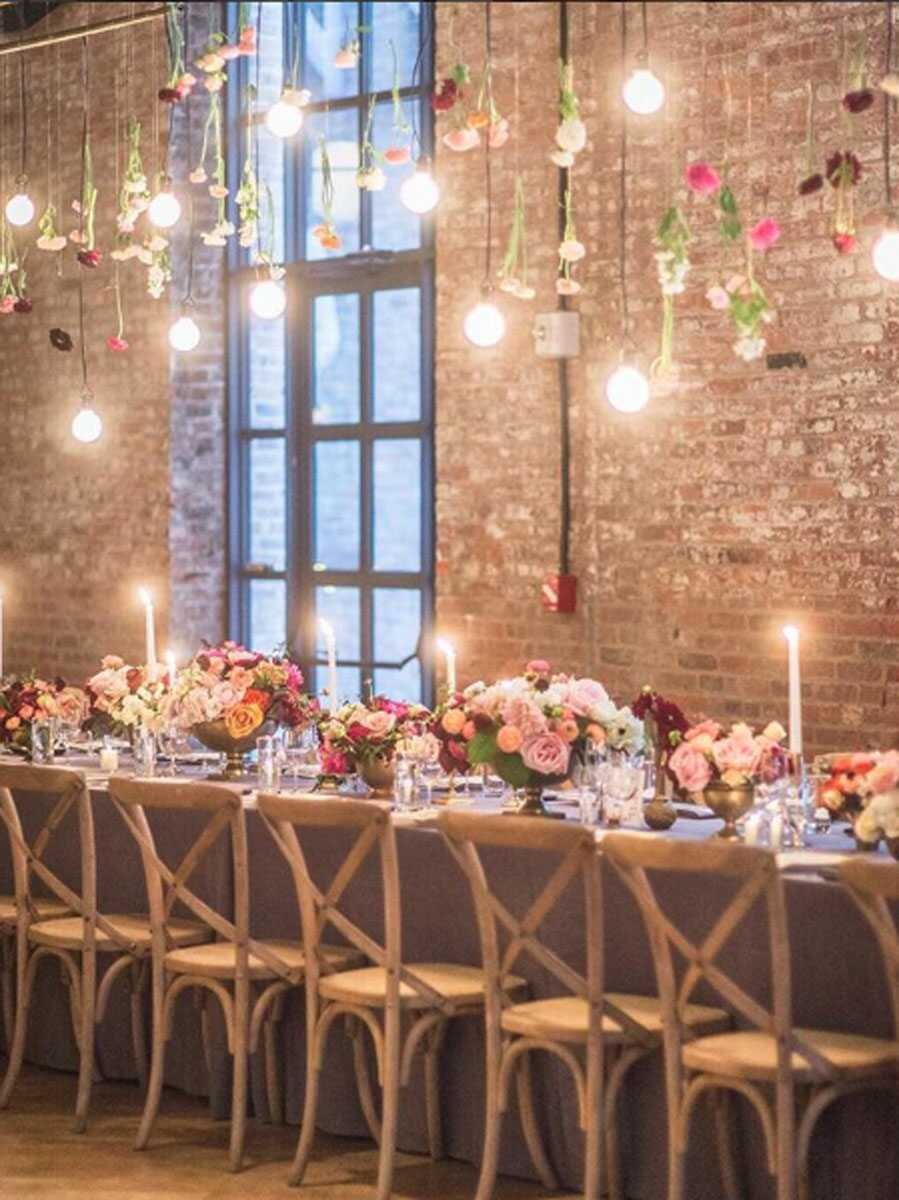 floral decorated table tops at Wythe Hotel main hall