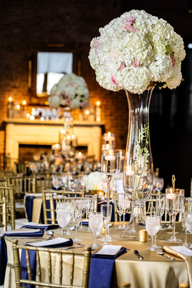 Tall Centerpieces with White Hydrangeas on Gold Round Tables