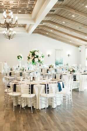 Elegant Tall Centerpieces and Ghost Chiavari Chairs