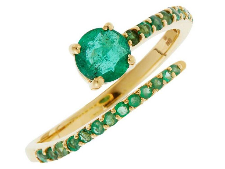 Open emerald engagement ring with pavé emerald band