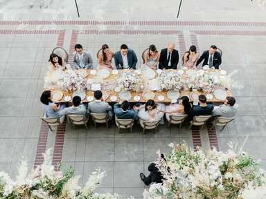 Guests eating meal around table outside