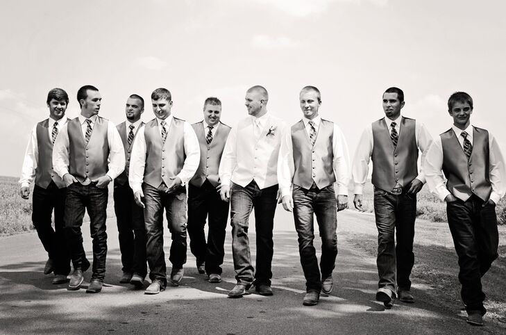 Justin and his groomsmen kept things casual in ivory and brown vests and ties, blue jeans and cowboy boots.