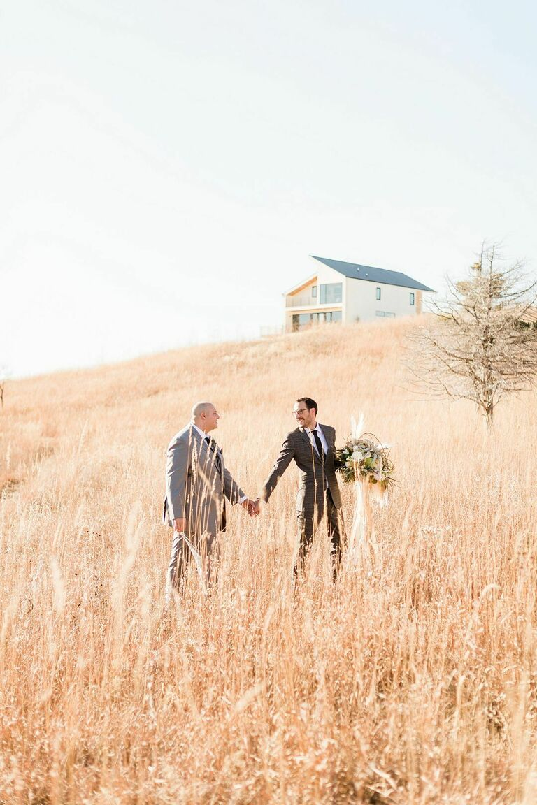 Wedding portraits in a field of grass