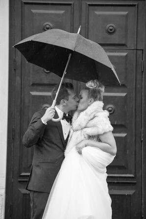 Bride and Groom Under an Umbrella