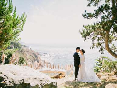 Bride and groom on a seaside cliff in Big Sur, California