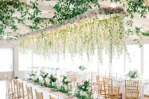 White Orchids Hanging Over Long Dining Tables