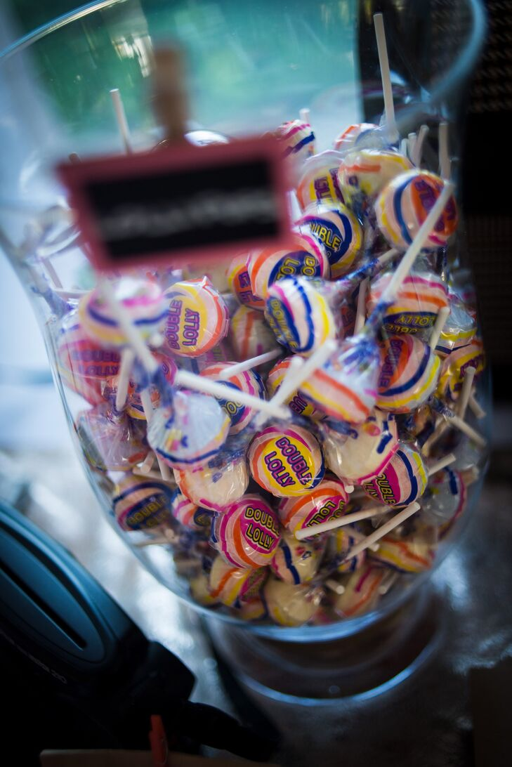 A jar filled with lollipops was offered to guests as a fun favor after dinner and the wedding cake.