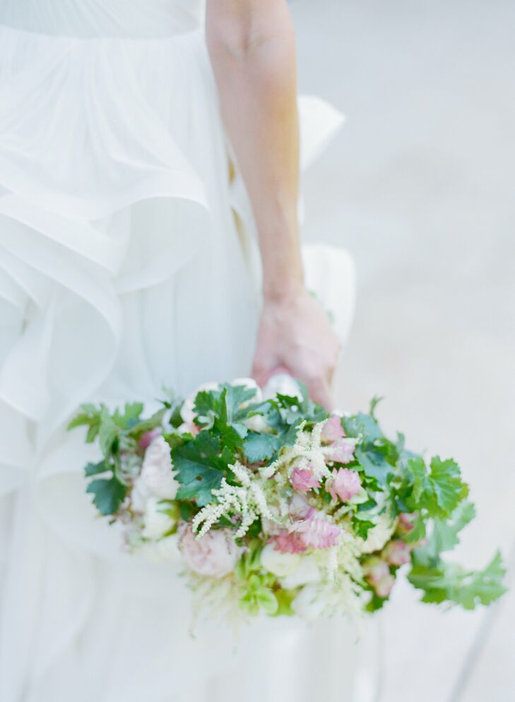 Katie's bridal bouquet was filled with soft pink and ivory flowers accented by wild greenery and berries for a rustic, romantic look.