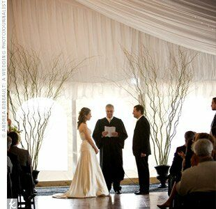Dennis' father, a judge, performed the ceremony in an airy tent loosely draped with white crepe curtains and strands of twinkling lights. Spindly green willow branches flanked the altar.
