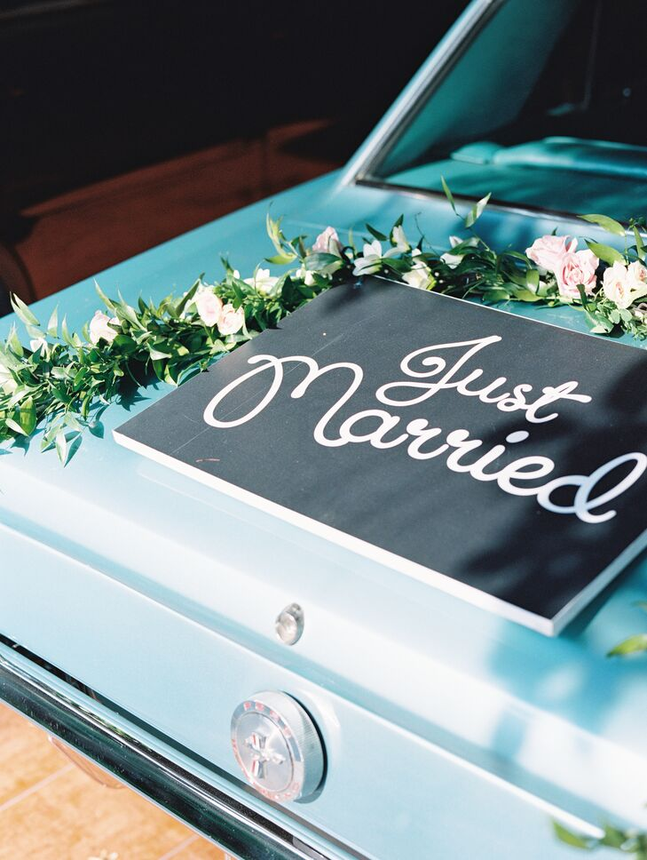 After a traditional Catholic ceremony in one of Honduras's oldest churches, Monique and Gabriel cruised to their reception in a blue vintage ride.