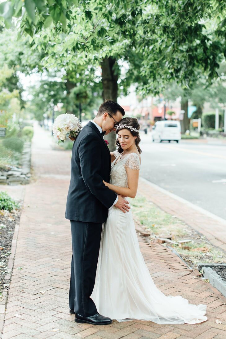 With a vintage-inspired theme in mind, Elizabeth wore a Maggie Sottero Ettia dress for her wedding day. The satin sheath gown featured an intricately embellished tulle overlay, beaded illusion cap sleeves and a classic V-shaped neckline that exuded old-world charm.