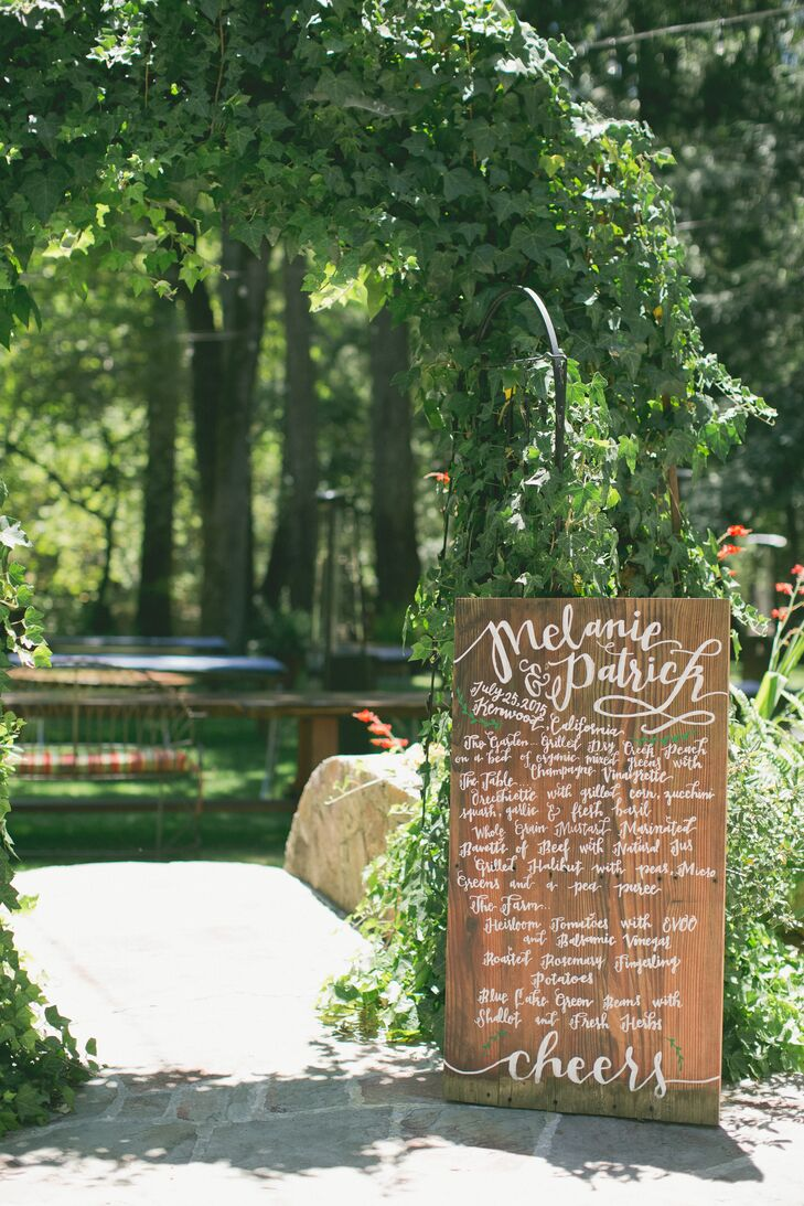 Melanie and Patrick's farm-to-table menu was scrawled in beautiful calligraphy on wooden signs.