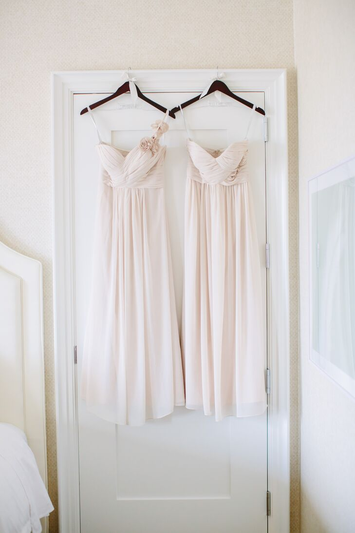 """""""I wanted something soft, long and flowy and fell in love with the dresses by Bill Levkoff,"""" says Stephanie. The bridesmaids wore strapless champagne floor-length dresses with a ruche detail on the bodice. Each paired the dress with a pearl bracelet and earrings given to them by the bride."""