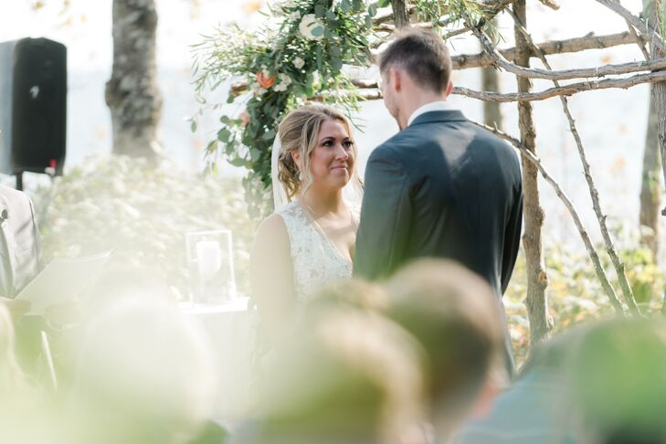 Couple Reciting Vows at Rustic Outdoor Ceremony
