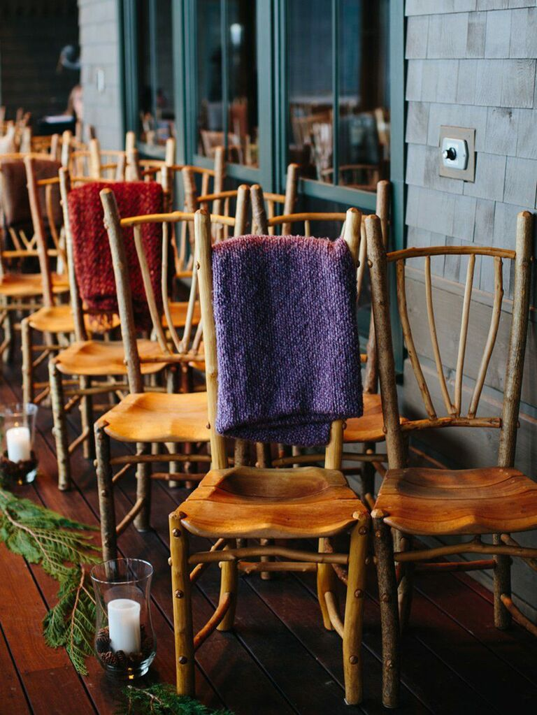 Rustic winter wedding ceremony chairs with blankets