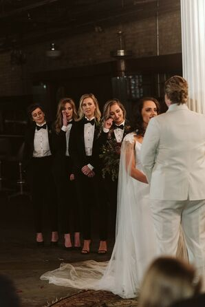 Alternative Bridesmaids in Fitted Black Suits and Bow Ties
