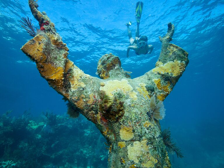 Underwater Christ of the Abyss statue near Key Largo with scuba diver in background
