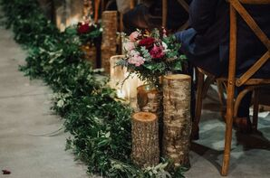 Rustic Winter Aisle Decorations of Greenery, Tree Stumps and Flowers
