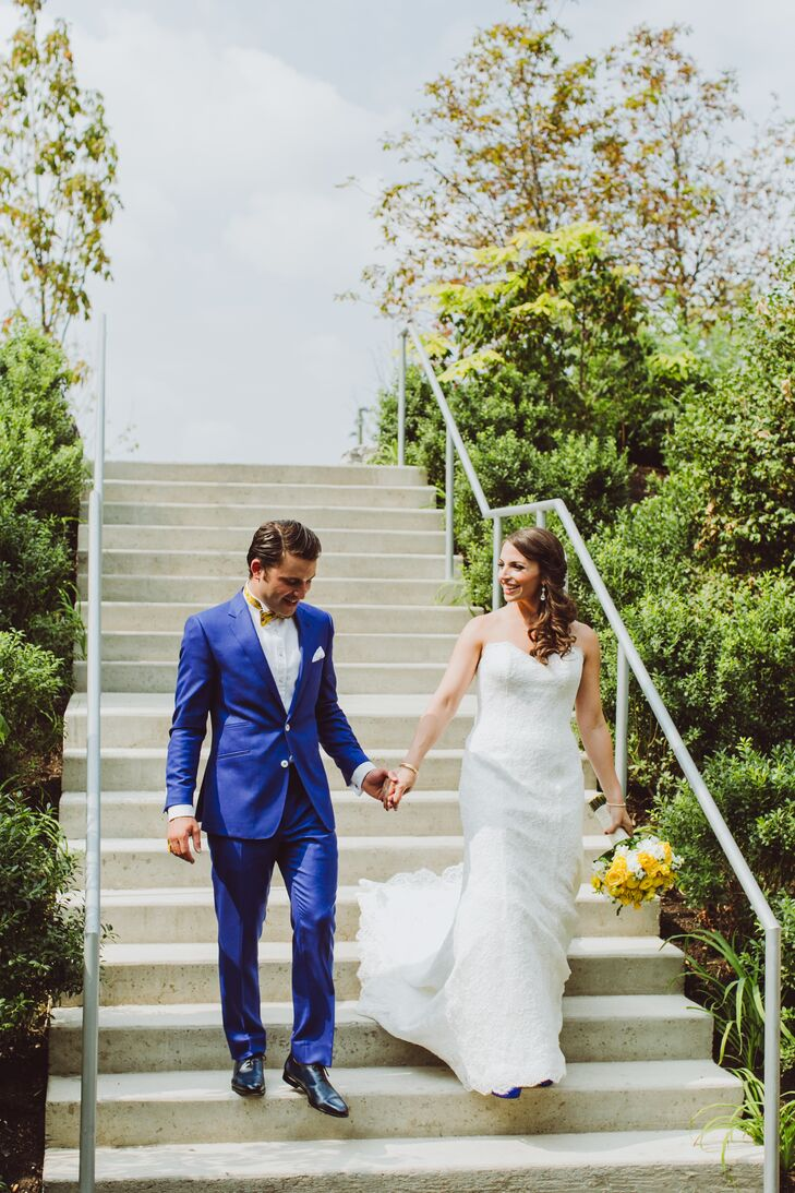 """I'm a colorful person, and my clothes are too,"" Edouard says. ""It was obvious to choose a bright blue tuxedo for our celebration."" The groom had two custom suits for the occasion, a royal blue number for the ceremony and a two-tone, 1970s-inspired tuxedo for the reception."