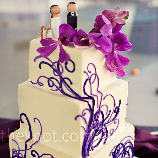 The mod square cake (decked out in the same glass art pattern as the invites) got a dose of playfulness from custom wooden peg toppers.