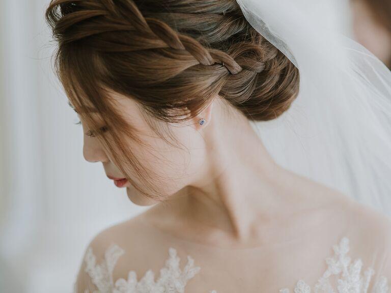 wedding updo bun with braid crown