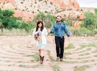 Ashley and Sam Santoscoy planned a bright bohemian desert wedding with cactus motifs and lots of handmade touches. The couple chose to host the festiv