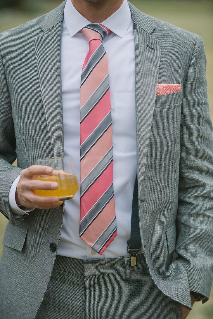 To complement the day's decor, Daniel wore a pink striped tie and pocket square with his light gray suit.