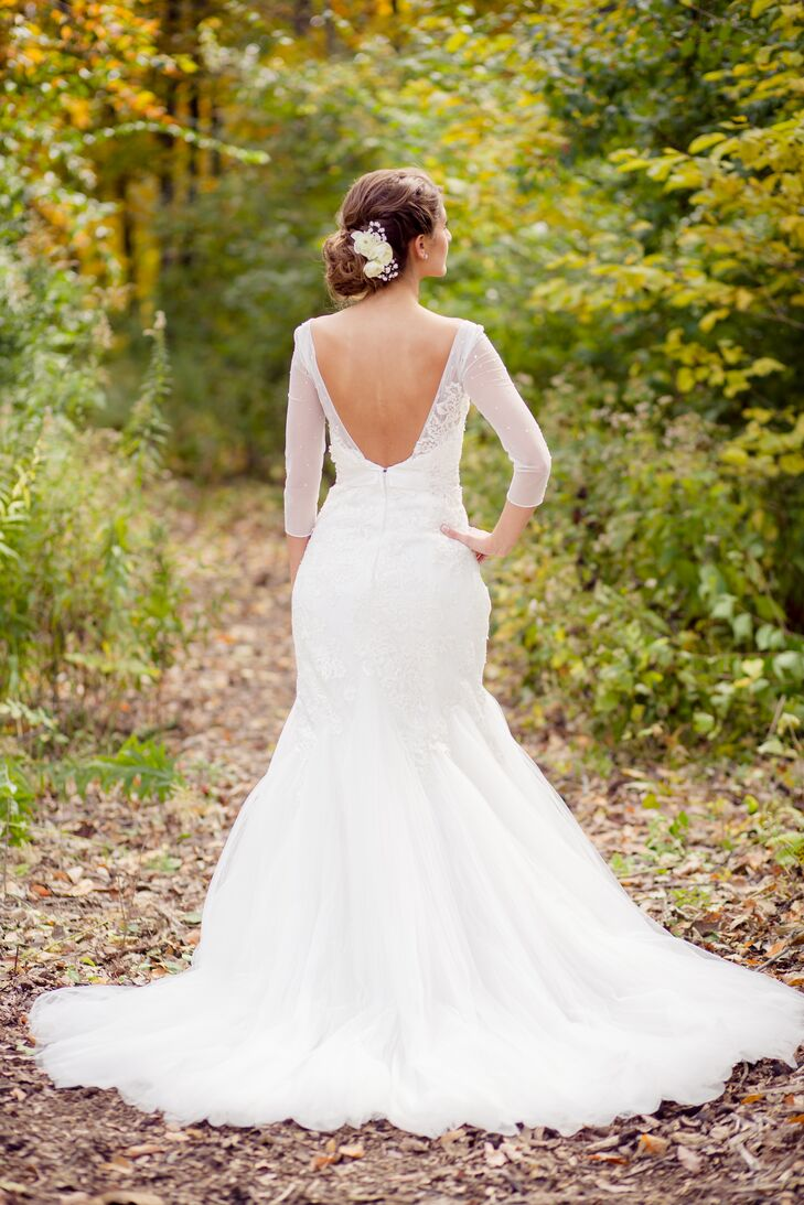 Lauren wore a spectacular Galina Signature trumpet-style wedding gown with delicate polka dots on the 3/4 length sleeves.