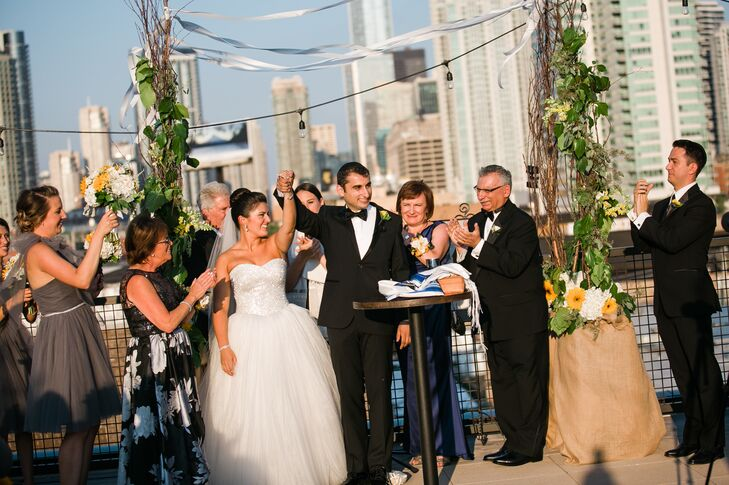"Alyse and Vadim incorporated a number of Jewish traditions into their ceremony beyond signing their ketubah beforehand with a small group of their closest family members and friends. ""We broke the glass, did the seven circles, were wrapped in a tallis and had family and friends recite the sheva bracot,"" says Alyse."