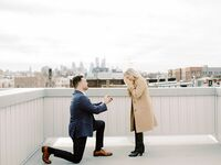 Man on one knee during surprise proposal photoshoot