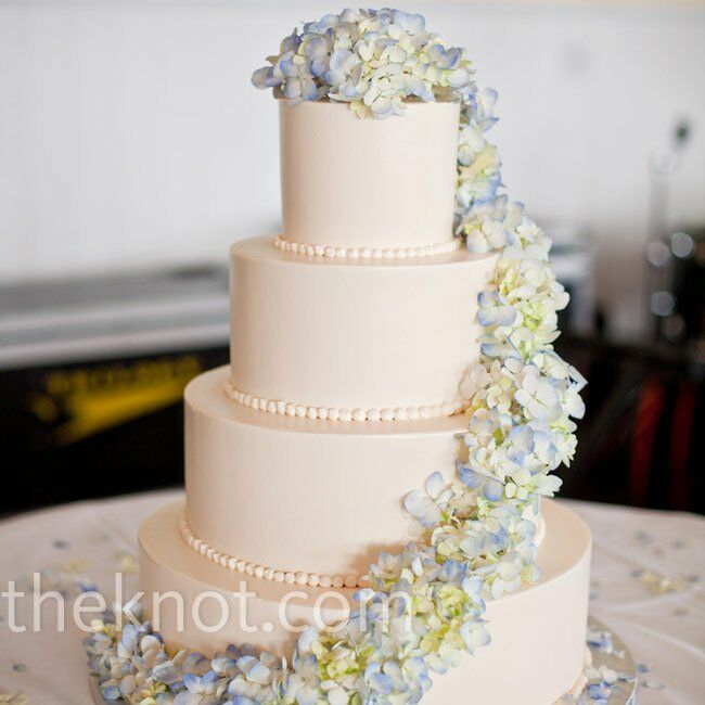Delicate hydrangeas cascaded down the four-tiered buttercream cake.