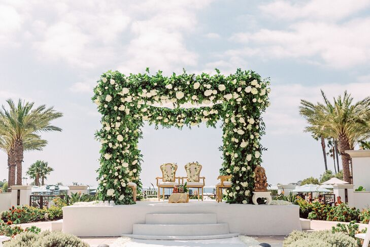Traditional Hindu Mandap Covered in Greenery and White Roses