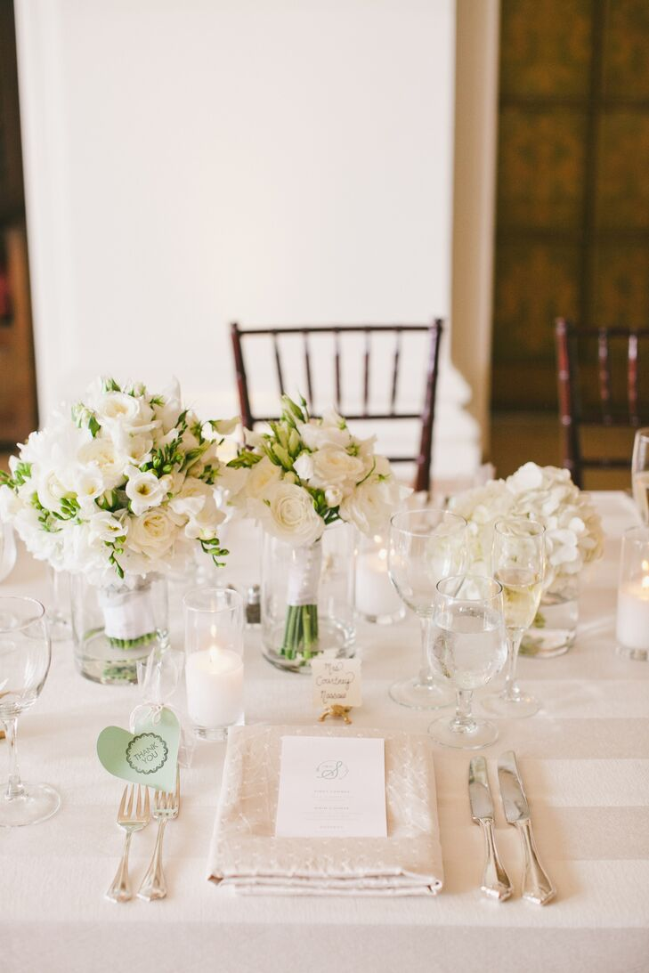 Though Margot and Ricky went with an all white color palette for their reception decor to create an elegant, spring-inspired aesthetic, subtle details, like patterned linens, varying floral arrangements and pint-sized gold alligators and bull dogs, nods to the couple's alma maters, introduced an element of depth and drama to the tablescapes.