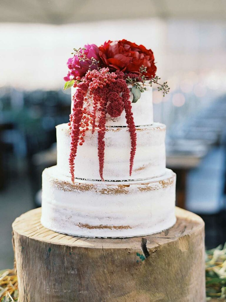 Semi-naked wedding cake with crimson florals