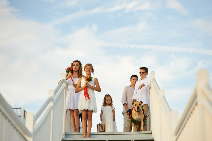 The sweet flower girls wore beachy white dresses, while the boys wore linen shirts and khaki pants.