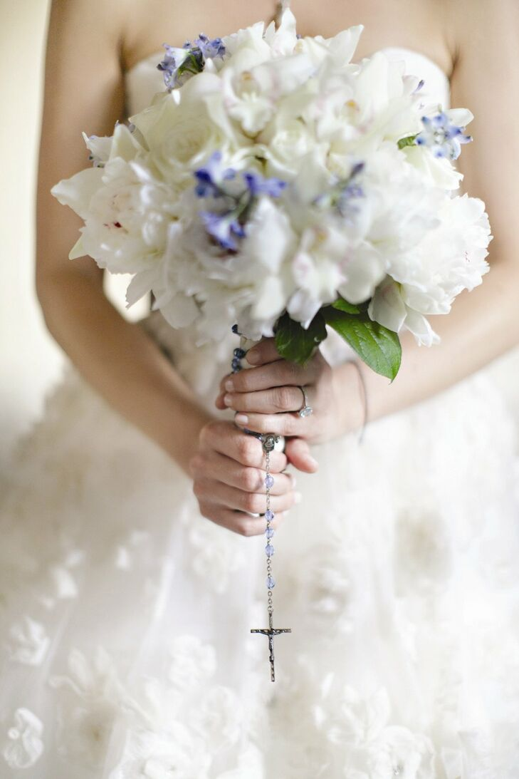 Erica's bouquet of white peonies and blue tweedia was accented with a blue beaded rosary.