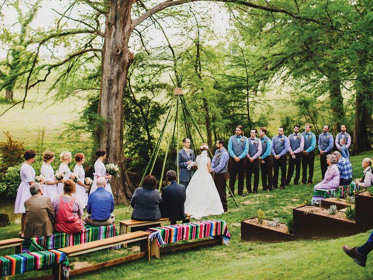 outdoor wedding ceremony under tipi structure