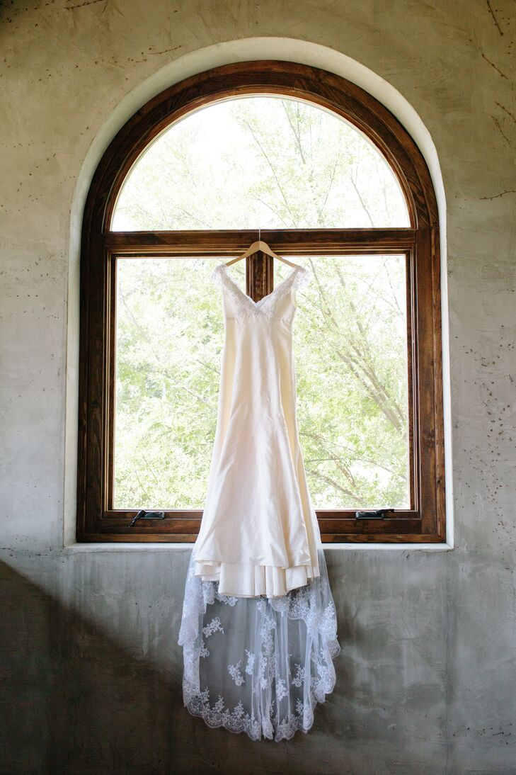 Deborah originally wanted a more elaborate gown. But after seeing the simple silhouette at the store, she chose this gown. Her mother added sleeves and beading for the big day, adding to the glamour.