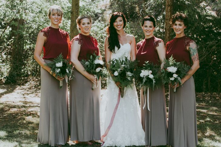 Mirroring the fabric of Rebecca's gown, her bridesmaids wore lacy burgundy tops with neutral gray skirts.