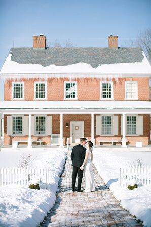 Married Couple Kissing in Front of House