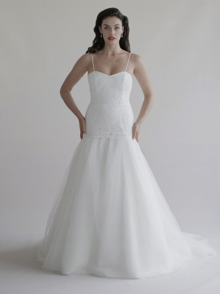 Catherine Kowalski Fall 2019 fit-and-flare wedding dress with a fitted bodice, spaghetti straps and tulle drop-waisted skirt