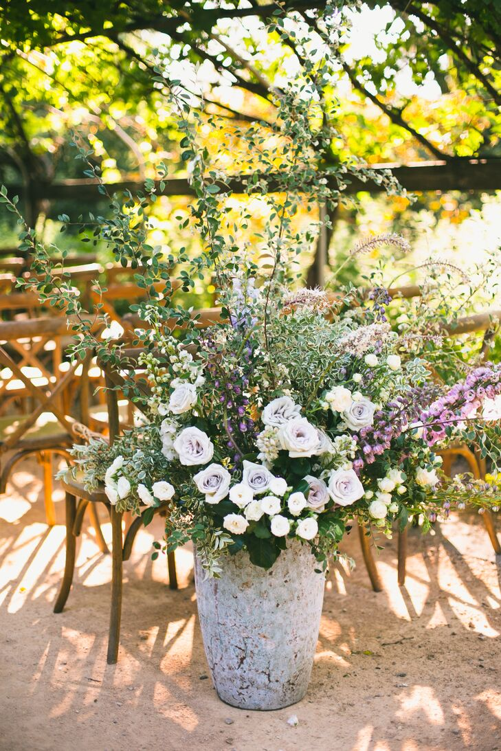 Stone Vases with Purple Roses, Peonies and Greenery