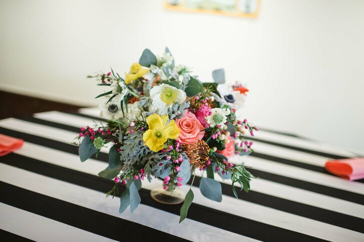 """""""My wedding planner, Camden with Emerson Events, picked out the florals based on bouquets I had pinned,"""" Erin says. """"She did an amazing job, and I almost cried when I saw them."""" The arrangements included anemones, poppies, scabiosa, pincushion proteas and greens."""