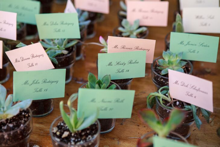 To help guests find the way to their seats, while playing up the wedding's locale, Maggie and Joseph placed escort cards with each guest's name and seating assignment in small pots boasting a single succulent.