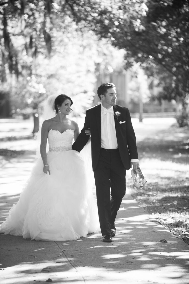 Chris continued the formal theme in a classic black tux with a white bow tie and pocket square. He and Amanda's classic, elegant styles fit the ambience of Savannah, Georgia, where they posed for photographs along the riverfront.