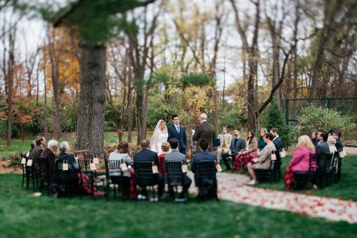 Under the large tree at Bear Mill Estate, Mindy and Christopher were wed for an intimate group of guests. The couple had no wedding party and walked down the aisle, which was covered in rose petals. Guests used blankets to keep warm in the November air.