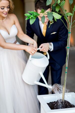 Bride and Groom Watering Tree During Unity Planting Ceremony