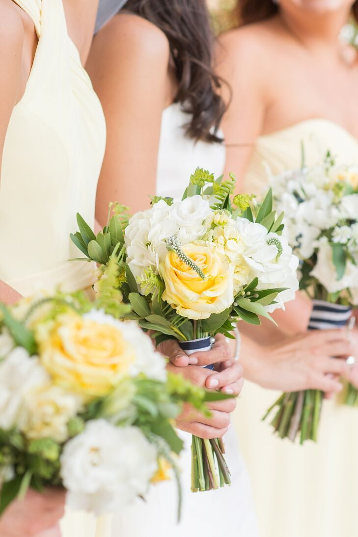 Her bridesmaids held mini versions of Pam's arrangement during the ceremony. Twisted Willow Flowers crafted each one with yellow roses, pale yellow delphiniums, white hydrangeas, white lisianthus, eucalyptus and more greenery gathered in a nautical wrap. Each stem matched the woman's classic yellow dress with a pop of natural flair.